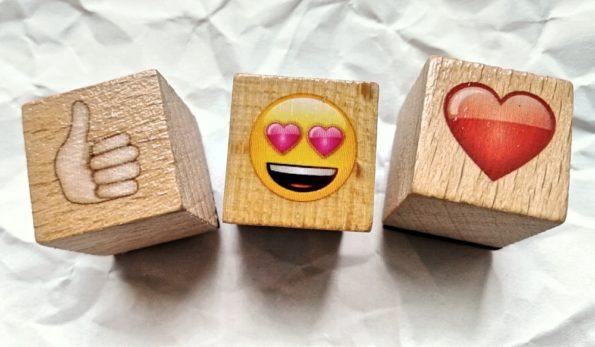 Drei Emojis, die zeigen, dass Firmenblogs mit gutem Content grandios sind.